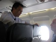 File picture shows Madagascar's ousted leader Marc Ravalomanana on a flight taking him from Johannesburg to Antananarivo on January 21. Madagascan leader Andry Rajoelina and the man he toppled, Ravalomanana, are set to hold landmark talks Wednesday to tackle the critical issues blocking the island's path to new elections