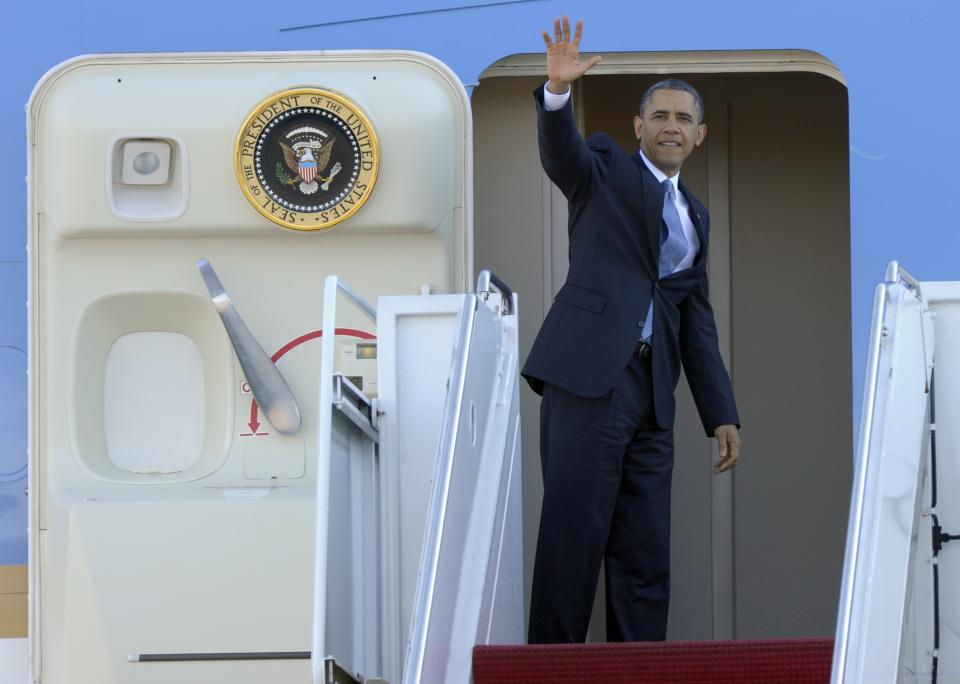 President Barack Obama waves from the top of the steps of Air Force One at Andrews Air Force Base in Md., Tuesday, Jan. 29, 2013. Obama is traveling to Las Vegas to deliver a speech on immigration. (AP Photo/Susan Walsh)