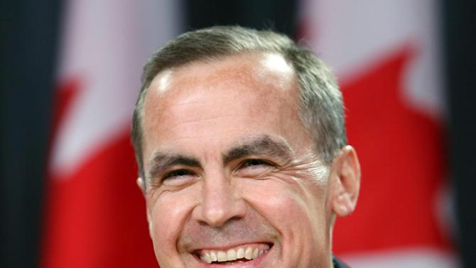 Bank of Canada Governor Mark Carney, right, smiles at a news conference in Ottawa, Ontario, Monday Nov. 26, 2012.  Carney will become head of the Bank of England next summer. (AP Photo/The Canadian Press, Fred Chartrand)