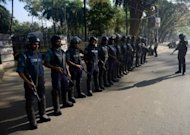 <p>Bangladeshi police keep watch outside the International Crimes Tribunal court premises during a nationwide strike in Dhaka, on February 28, 2013. At least 34 people were killed in a wave of violence on Thursday as Islamists reacted furiously to a ruling that one of their leaders must hang for war crimes during the 1971 independence conflict.</p>