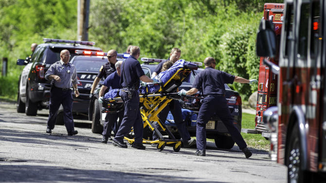 In this Saturday, May 31, 2014 photo, rescue workers take a stabbing victim to the ambulance in Waukesha, Wis. Prosecutors say two 12-year-old southeastern Wisconsin girls stabbed their 12-year-old friend nearly to death in the woods to please a mythological creature they learned about online. Both girls were charged as adults with first-degree attempted homicide Monday in Waukesha County Circuit Court. According to a criminal complaint, the girls had been planning to kill their friend for months and finally made the attempt in a park on Saturday morning, after a slumber party. (AP Photo/Abe Van Dyke)