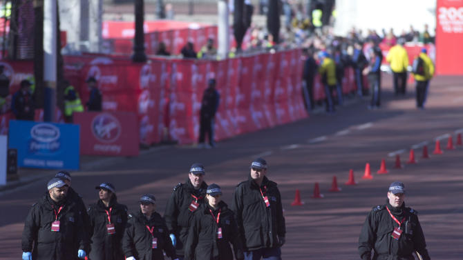 British police officers make final checks in the Mall, prior to the beginning of the London Marathon near to the finish line for marathon is situated in London, Sunday, April  21, 2013. Security has been stepped up in London following the recent bombs at the Boston Marathon. The London Marathon started as planned on a glorious sunny morning Sunday despite concerns raised by the bomb attacks on the Boston Marathon six days ago. (AP Photo/Alastair Grant)