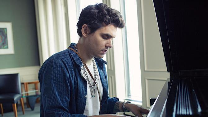 """This Aug. 12, 2013 file photo shows singer-songwriter John Mayer sits at a piano in New York. Mayer is releasing his sixth album, """"Paradise Valley,"""" on Tuesday, Aug. 20. It features collaborations with his singer-girlfriend Katy Perry and R&B singer Frank Ocean. (Photo by Victoria Will/Invision/AP)"""