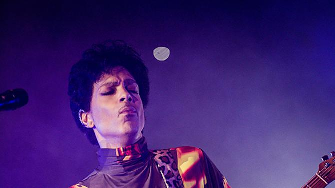This Fall 2012 publicity photo provided by Rogers and Cowan shows musician Prince performing in concert in Chicago. Prince turns off the lights at South by Southwest on Saturday, March 16, 2013, with an unexpected and intimate showcase that ranks among the biggest surprises in years at the star-studded music festival and conference. (AP Photo/Rogers and Cowan)