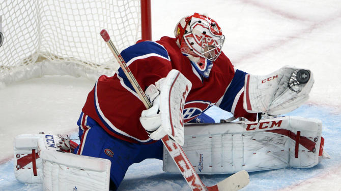 Montreal Canadiens goalie Carey Price makes a glove-save against the Ottawa Senators during second-period NHL hockey Game 2 first-round playoff action in Montreal, Friday, May 3, 2013. (AP Photo/The Canadian Press, Ryan Remiorz)