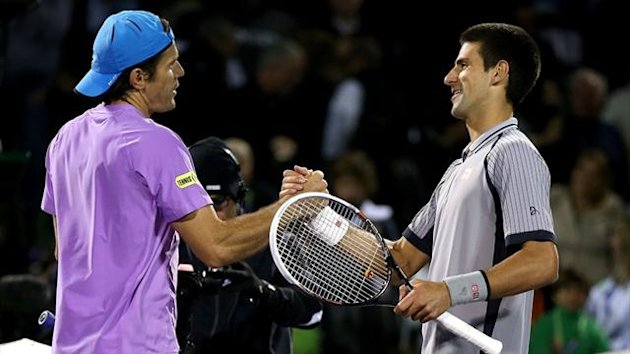 Novak Djokovic congratulates Tommy Haas on his win at the Miami Masters (AFP)