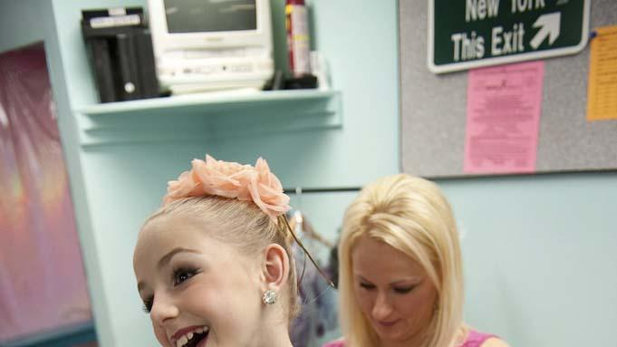 "Christi helps her daughter Chloe get ready for a performance in ""Dance Moms."""