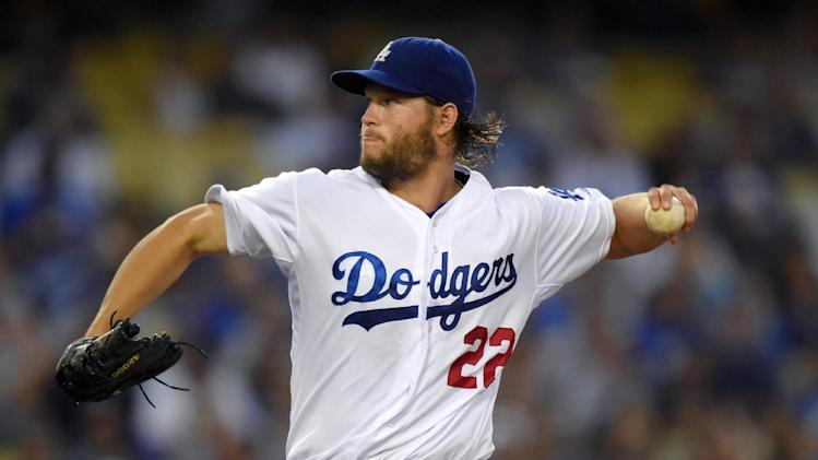 Los Angeles Dodgers starting pitcher Clayton Kershaw throws to the plate during the first inning of a baseball game against the Washington Nationals, Tuesday, Sept. 2, 2014, in Los Angeles. (AP Photo/Mark J. Terrill)