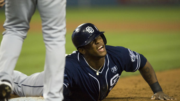 The Padres' Rymer Liriano reacts after a pick-off attempt against the Dodgers during their baseball game at Dodgers Stadium in Los Angeles on Wednesday, Aug. 20, 2014. (AP Photo/The Orange County Register, Foster Snell)