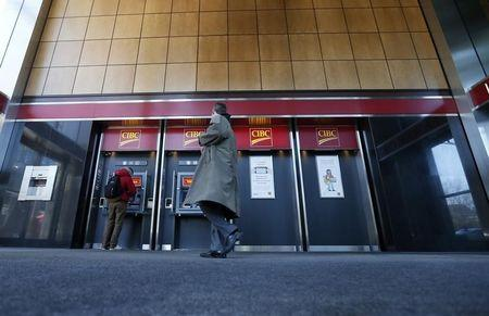 Pedestrians use the CIBC ATM machines in Montreal