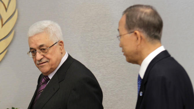Palestinian President Mahmoud Abbas, left, enters the room with United Nations Secretary-General Ban Ki-moon during the 66th session of the General Assembly at United Nations headquarters Monday, Sept. 19, 2011. (AP Photo/Seth Wenig)