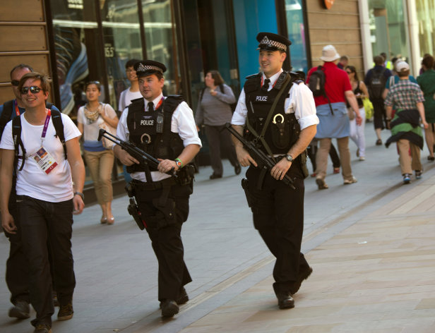 Police officers patrol near the Olympic Park in London, Monday, July 23, 2012. Opening ceremonies for the 2012 London Olympics are scheduled for Friday, July 27. (AP Photo/Emilio Morenatti)