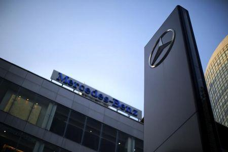 A Mercedes-Benz logo and sign are seen at a dealership in downtown Shanghai