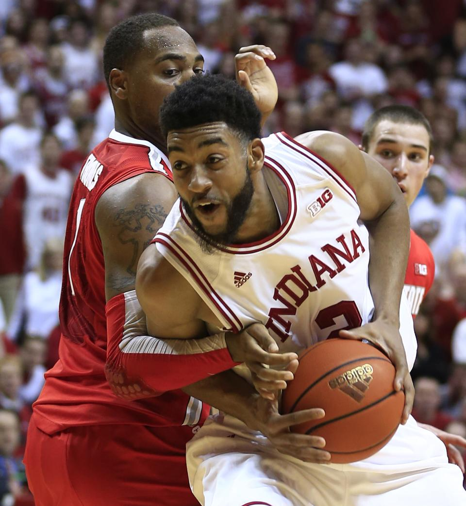Indiana's Christian Watford, right, is defended by Ohio State's Deshaun Thomas during the second half of an NCAA college basketball game, Tuesday, March 5, 2013, in Bloomington, Ind. Ohio State won 67-58. (AP Photo/Darron Cummings)