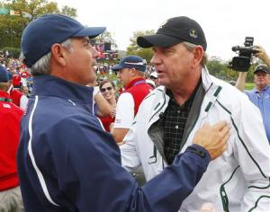 International captain Nick Price (R) congratulates U.S. captain Fred Couples after the U.S. won the 2013 Presidents Cup golf tournament at Muirfield Village Golf Club in Dublin