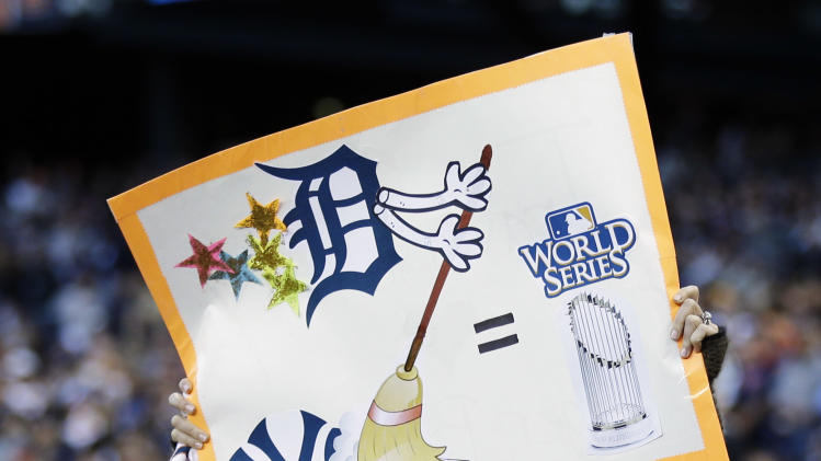 A Detroit Tigers fans holds up a sign in the fifth inning during Game 4 of the American League championship series against the New York Yankees Thursday, Oct. 18, 2012, in Detroit. (AP Photo/Paul Sancya )