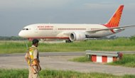 In this photograph taken on September 8, 2012, a security serviceman looks on as Air India's first Boeing 787 Dreamliner at Indira Gandhi International airport in New Delhi. An electrician accidentally unplugged the radar system at the Indian capital's airport, forcing air traffic controllers to manually guide in aircraft, media reports said on Saturday
