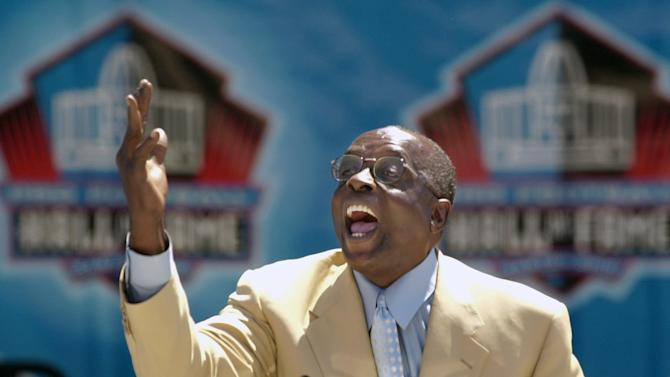 FILE - In this Aug. 3, 2002 file photo, Hall of Fame defensive end Deacon Jones presents the late coach George Allen for enshrinement into the Pro Football Hall of Fame in Canton, Ohio. Jones, the original sackmaster, has died. The Hall of Fame defensive end credited with terming the word sack for how he knocked down quarterbacks, was 74. The Washington Redskins said that Jones died of natural causes at his home in Southern California on Monday night, June 3, 2013. (AP Photo/Mark Duncan, File)