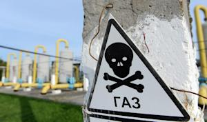 A danger sign is displayed near an underground gas …