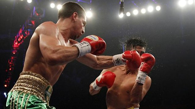 Danny Garcia delivers a punch to Erik Morales