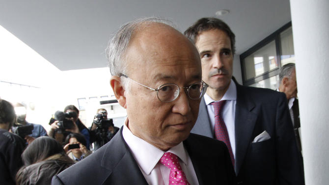 """Director General of the International Atomic Energy Agency, IAEA, Yukiya Amano from Japan returns from Iran at the Vienna International Airport near Schwechat, Austria, on Tuesday, May 22, 2012. Amano says he has reached a deal with Iran on probing suspected work on nuclear weapons and adds that the agreement will """"be signed quite soon."""" (AP Photo/Ronald Zak)"""