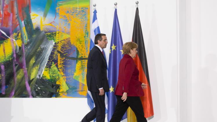 German Chancellor Angela Merkel, right, welcomes the Prime Minister of Greece, Antonis Samaras for a meeting at the chancellery in Berlin, Tuesday, Jan. 8, 2013. (AP Photo/Markus Schreiber)