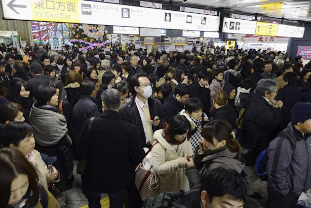 People crowd at Sendai railway station in Sendai, Miyagi Prefecture, Friday, Dec. 7, 2012 after trains were halted following a strong earthquake struck off the coast of northeastern Japan. It is the s