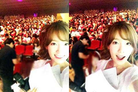 SNSD's Taeyeon Takes a Picture With SNSD Fans in 'Music Core' Audience