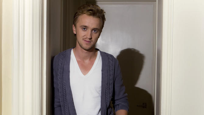 "FILE - In this Nov. 12, 2010 file photo, British actor Tom Felton poses for photographs in London. Felton portrays Draco Malfoy in ""Harry Potter and the Deathly Hallows: Part 2."" (AP Photo/Joel Ryan)"