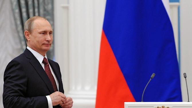 Russian President Vladimir Putin, pictured in Moscow on May 1, 2015, ratified an accord to set up a $100-billion reserve fund for the so-called BRICS