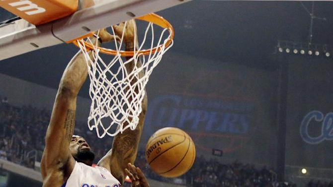 Los Angeles Clippers center DeAndre Jordan (6) dunks over Oklahoma City Thunder center Kendrick Perkins (5) in the first half of an NBA basketball game in Los Angeles, Sunday, March 3, 2013. (AP Photo/Reed Saxon)