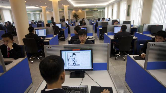 In this April 13, 2011 photo, people work on library computers at Kim Il Sung University in Pyongyang, North Korea. North Korea is undergoing a digital revolution of sorts, even as it holds some of the strictest cyberspace policies in the world. (AP Photo/David Guttenfelder)