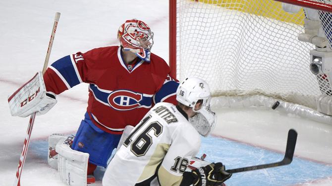 Montreal Canadiens goaltender Carey Price, left, is scored on by Pittsburgh Penguins' Brandon Sutter during overtime in an NHL hockey game Saturday, March 2, 2013, in Montreal. Pittsburgh won 7-6. (AP Photo/The Canadian Press, Graham Hughes)