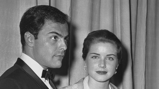 FILE - In this April 4, 1960 file photo, actor John Saxon and actress Dolores Hart arrive at Pantages Theater in Hollywood, Calif., for the Academy Awards show. Hart, whose luminous blue eyes entranced Elvis Presley in his first on-screen movie kiss, is now a cloistered nun and praying for a Christmas miracle. She walked away from Hollywood stardom in 1963 to become a nun in rural Bethlehem, Conn. Now she finds herself back in the spotlight, but this time it's all about serving the King of Kings, not smooching the King of Rock and Roll. The former brass factory that houses Mother Dolores and about 40 other nuns cloistered at the Abbey of Regina Laudis in Bethlehem, Conn., needs millions of dollars in renovations to meet fire and safety codes, add an elevator and make handicap accessibility upgrades. (AP Photo, File)