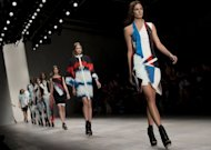 Models present creations by Jean-Pierre Braganza during the 2013 spring/summer collection catwalk show at London Fashion Week. The week kicked off with a colourful show by British duo Antoni and Alison, who marked their 25th year in style with a striking array of painted silk dresses