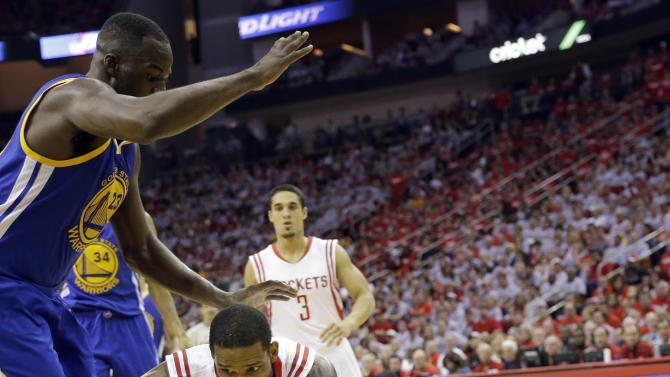 Houston Rockets forward Trevor Ariza (1) loses the ball as Golden State Warriors forward Draymond Green (23) defends during the second half in Game 3 of the NBA basketball Western Conference finals Saturday, May 23, 2015, in Houston. (AP Photo/David J. Phillip)