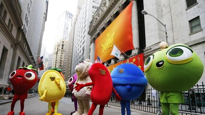 """Mascots dressed as characters from the mobile video game """"Candy Crush Saga"""" pose outside the New York Stock Exchange"""