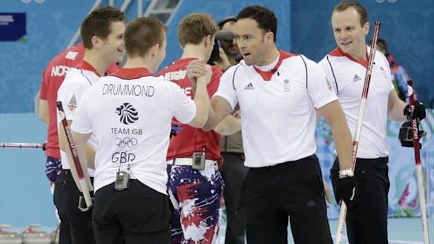 Britain's second Scott Andrews (front L-R), vice Greg Drummond, skip David Murdoch and lead Michael Goodfellow celebrate during their men's tie-breaker curling game against Norway at the Ice Cube Curling Centre during the Sochi 2014 Winter Olympic Games F