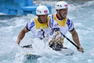 "Britain's Tim Baillie (L) and Etienne Stott compete for gold in the Canoe Double Men's Slalom Semi-final at the ""Lee Valley White Water Centre"", in London, on day 6 of the London 2012 Olympic Games"