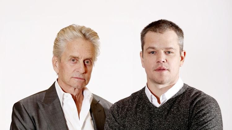 """In this Jan. 4, 2013 photo, actors Michael Douglas, left, and Matt Damon, from the HBO film """"Behind the Candelabra"""", pose for a portrait in Pasadena, Calif. The film premieres Sunday, May 26, at 9 p.m. EDT on HBO. (Photo by Matt Sayles/Invision/AP)"""
