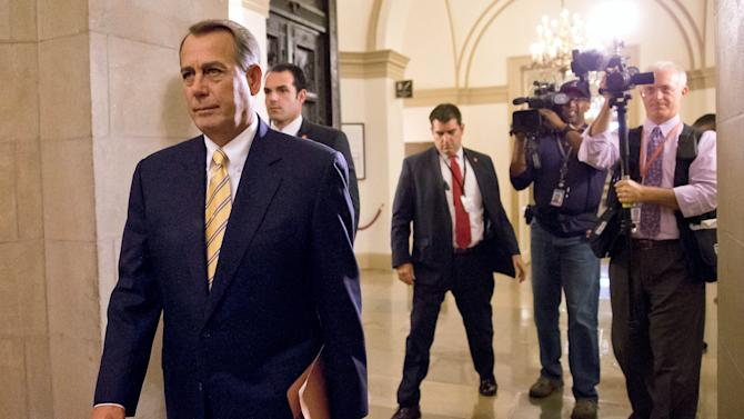 House Speaker John Boehner of Ohio arrives on Capitol Hill in Washington, Wednesday, Oct. 9, 2013. President Barack Obama is pressuring Boehner to hold votes to avoid a potentially catastrophic default and re-open the federal government, as a new poll indicated Republicans could pay a political price for Washington's fiscal paralysis. (AP Photo/J. Scott Applewhite)