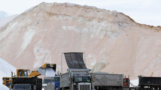 Crews load road salt into trucks in Chelsea ahead of a major winter storm forecasted for the northeastern United States
