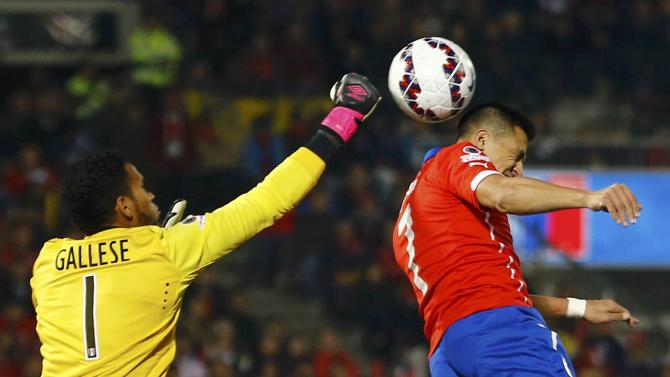 Peru's goalie Gallese jumps for the ball with Chile's Sanchez during their Copa America 2015 semi-final soccer match at the National Stadium in Santiago
