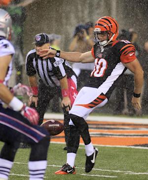 Huber's punt during storm saves Bengals