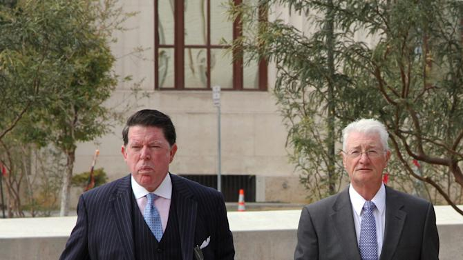 ADDS SENTENCING DETAILS - British Businessman Christopher Tappin, right, and his lawyer Dan Cogdell, arrive at Federal court in El Paso, Texas, Wednesday, Jan. 9, 2013. U.S. District Judge David Briones sentenced Tappin Wednesday to two years and nine months in prison, and said he would recommend that the Department of Justice approve any request by Tappin to be transferred to the United Kingdom. Tappin pleaded guilty in November to trying to buy missile parts and resell them to Iran. (AP Photo/Juan Carlos Llorca)