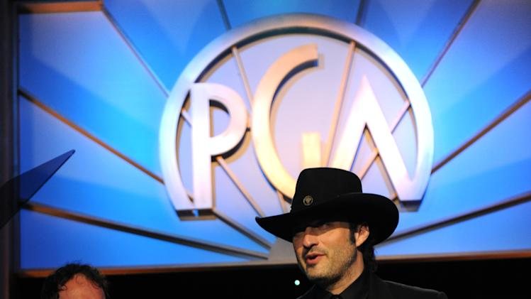 Quentin Tarantino and Robert Rodriguez onstage at the 24th Annual Producers Guild (PGA) Awards at the Beverly Hilton Hotel on Saturday Jan. 26, 2013, in Beverly Hills, Calif. (Photo by Jordan Strauss/Invision for Producers Guild/AP Images)