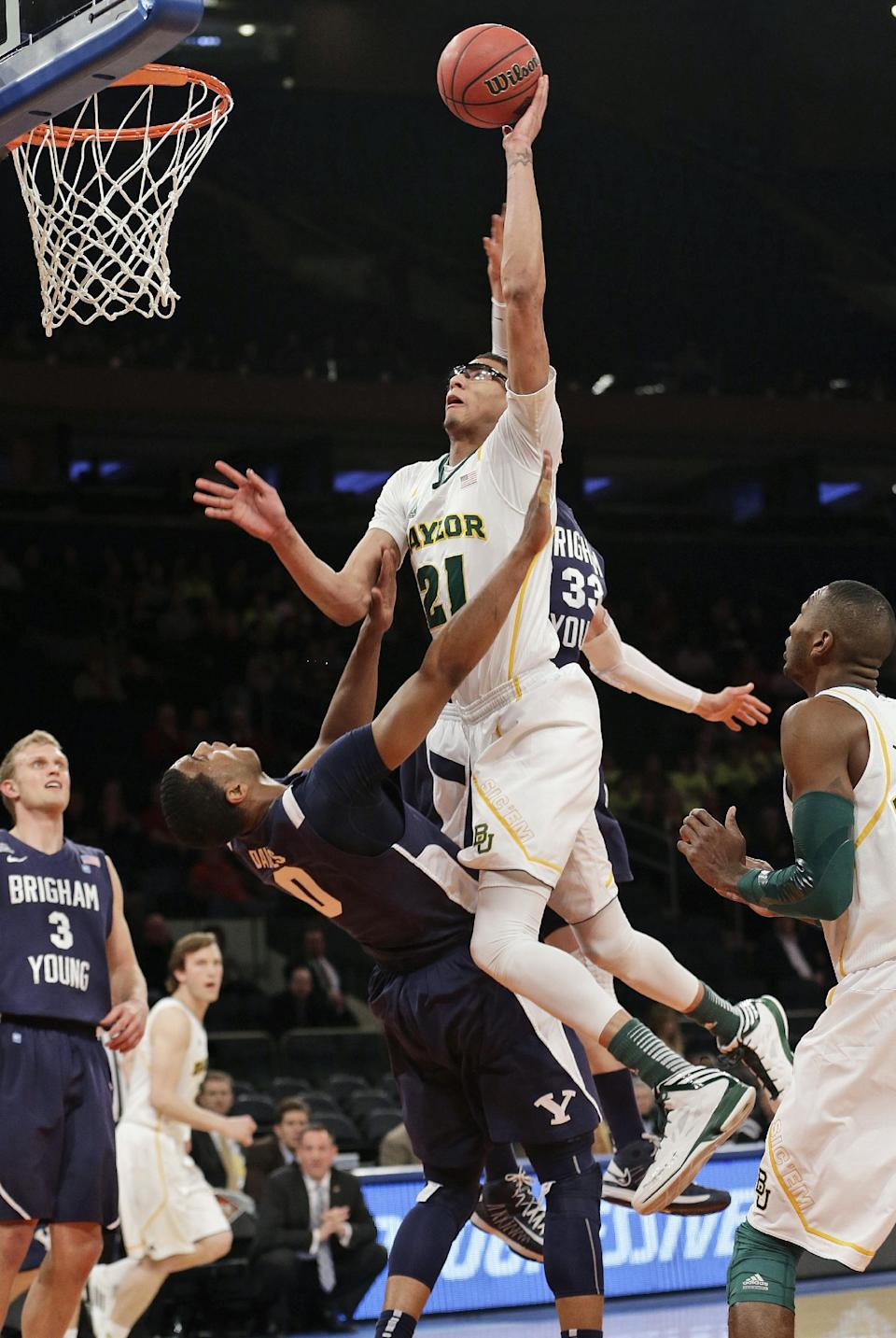 Baylor's Isaiah Austin (21) shoots over Brigham Young's Brandon Davies (0) during the first half of an NIT semifinal basketball game Tuesday, April 2, 2013, in New York. (AP Photo/Frank Franklin)