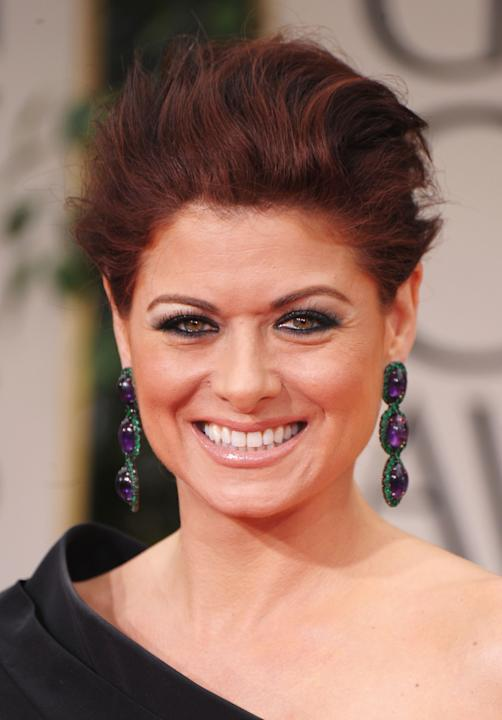 MISS: I feel so mean about this because I think Debra Messing genuinely tries, but she always goes a tad overboard in the make-up department. Her foundation is caked on, and all that eyeliner actually