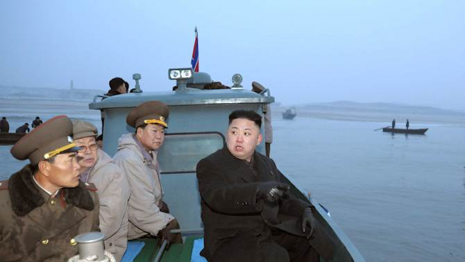In this March 7, 2013 photo released by the Korean Central News Agency (KCNA) and distributed March 8, 2013 by the Korea News Service, North Korean leader Kim Jong Un, with military officials, gets a ride on a boat on his way to a military unit on Jangjae Islet, located in the southernmost part of the southwestern sector of North Korea's border with South Korea. Seven years of U.N. sanctions against North Korea have done nothing to derail Pyongyang's drive for a nuclear weapon capable of hitting the United States. They may have even bolstered the Kim family by giving their propaganda maestros ammunition to whip up anti-U.S. sentiment and direct attention away from government failures.   (AP Photo/KCNA via KNS) JAPAN OUT UNTIL 14 DAYS AFTER THE DAY OF TRANSMISSION