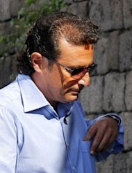 Former Costa Concordia captain Francesco Schettino in Meta di Sorrento on October 14. Schettino is accused of abandoning ship before its evacuation was complete. He has claimed he fell onto a lifeboat when the ship keeled over. Europe's top cruise operator has come under pressure at pre-trial hearings into the Costa Concordia disaster as Schettino faced survivors for the first time